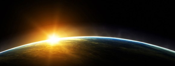 sun rising over the earth